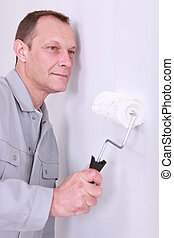 craftsman painting a wall