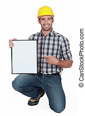 craftsman pointing at a blank board