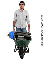 craftsman pushing a wheelbarrow