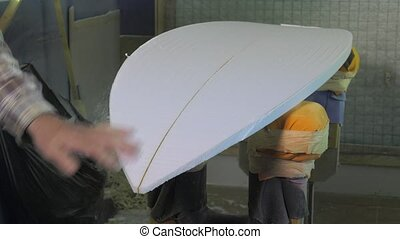 craftsman shaper of surfboards - cutting and shaping the...