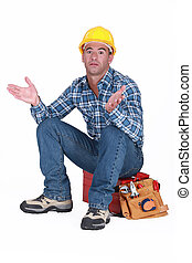 craftsman sitting on his toolbox and gesturing