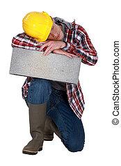 craftsman sleeping on a stone block