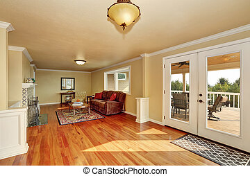 Craftsman-style family room with hardwood floor.
