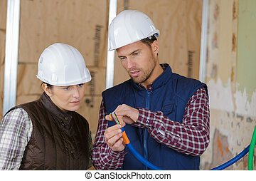craftsman talking to female co-worker
