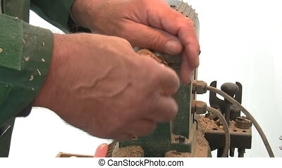 Craftsman wax polishing souvenir - Close up of hands of wood...