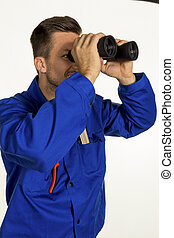 craftsman with binoculars - a worker in a business...