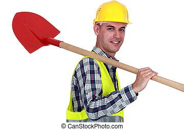 craftsman with shovel on his shoulder