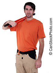 Craftsman with tool on shoulder