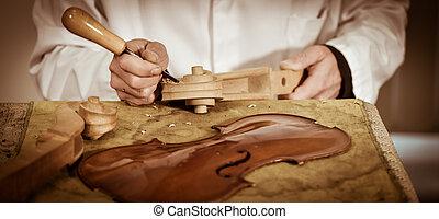 Craftsman working in workshop lutemaker