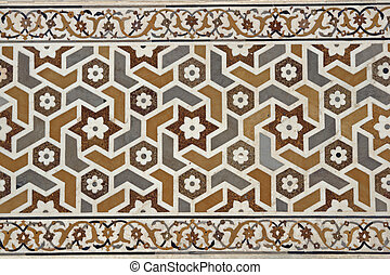 Craftsmanship - Detail of ornate inlaid white marble of the...