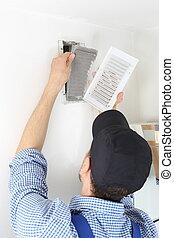 Craftsmen changing a Ventilation filter 3 - A Craftsmen...
