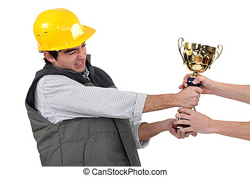 craftsmen fighting for a golden cup