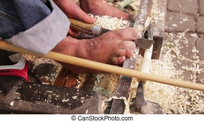 Craftsmen making wooden souvenir pipes at the bazaar...