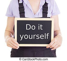 Businessman with wording do it yourself stock photographs search craftsperson with blackboard do it yourself solutioingenieria Gallery