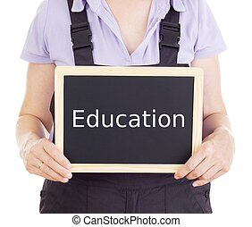 Craftsperson with blackboard: education