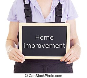Craftsperson with blackboard: home improvement