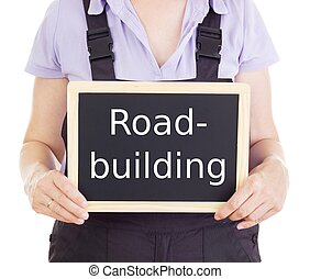 Craftsperson with blackboard: road-building