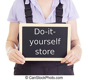 Craftsperson with blackboard: do-it-yourself store