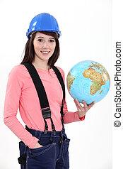craftswoman holding a globe