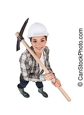 craftswoman holding a pickaxe