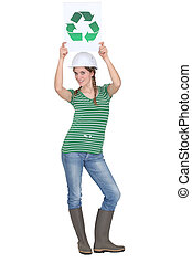 craftswoman holding a recycling label