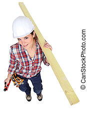 craftswoman holding a wooden piece