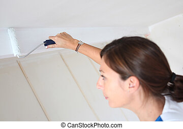 craftswoman painting a room
