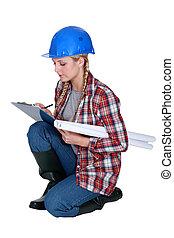 craftswoman taking notes