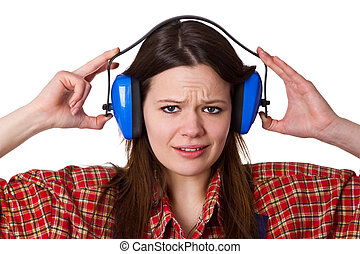 Young woman with hearing protectors - isolated