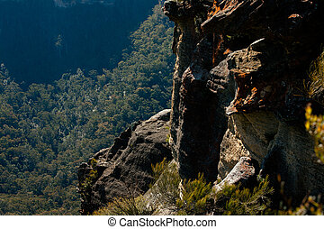 Craggy Mountainside Over the Forest - Craggy mountainside in...