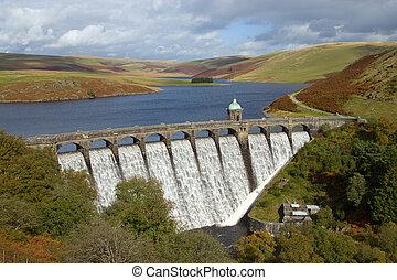 Craig Goch reservoir with water overflowing, Elan Valley,...