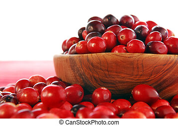 Cranberries in a bowl - Fresh red cranberries in a wooden...