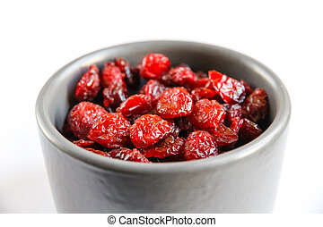 Cranberries in a bowl isolated on white background
