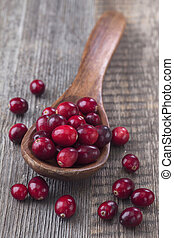 Cranberries in a spoon