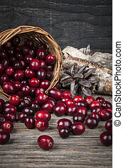 Cranberries in basket - Fresh ripe cranberries spilling out ...