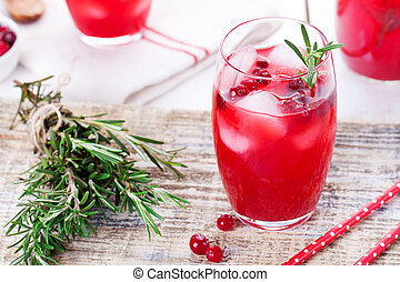 Cranberry and rosemary lemonade, cocktail, fizz on a wooden...