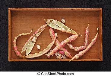 Cranberry beans in a wooden box
