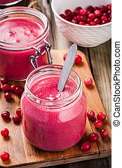 Cranberry curd in a glass jar