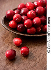Cranberry - Fresh organic cranberries on a wooden spoon