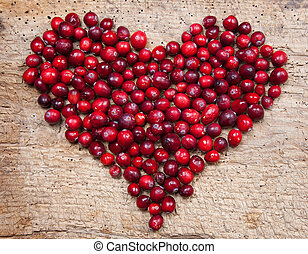 Cranberry heart - Heart of fresh cranberries on a wooden...