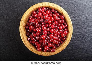 cranberry on a black background