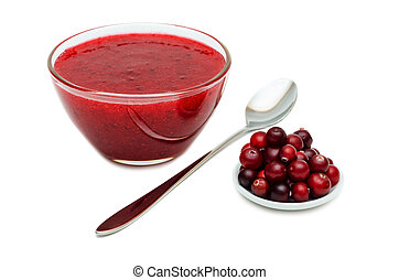 Cranberry Sauce, Glass bowl with cranberries, spoon, isolated on white background