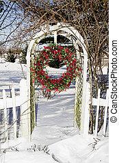 Cranberry Wreath Hanging in Trellis