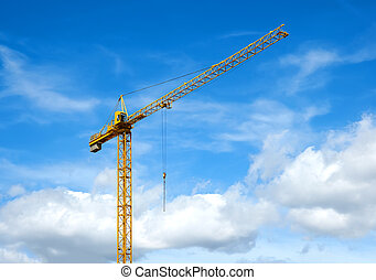 Crane against blue sky with white clouds