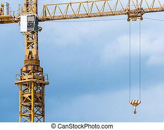 Crane against the blue sky