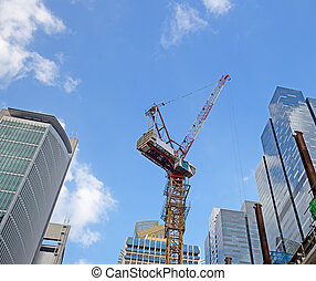 crane among skyscrapers