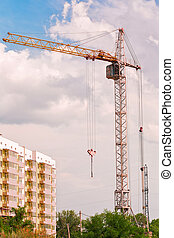 Crane and building at costruction site