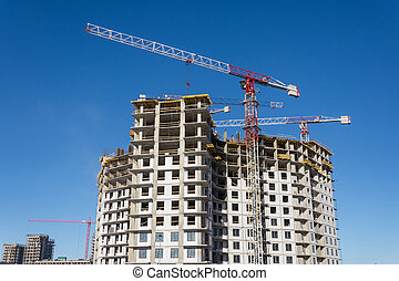 Crane and building construction site, look up view.