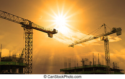 crane and building construction and sun set sky