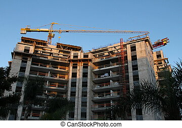 Crane and construction building